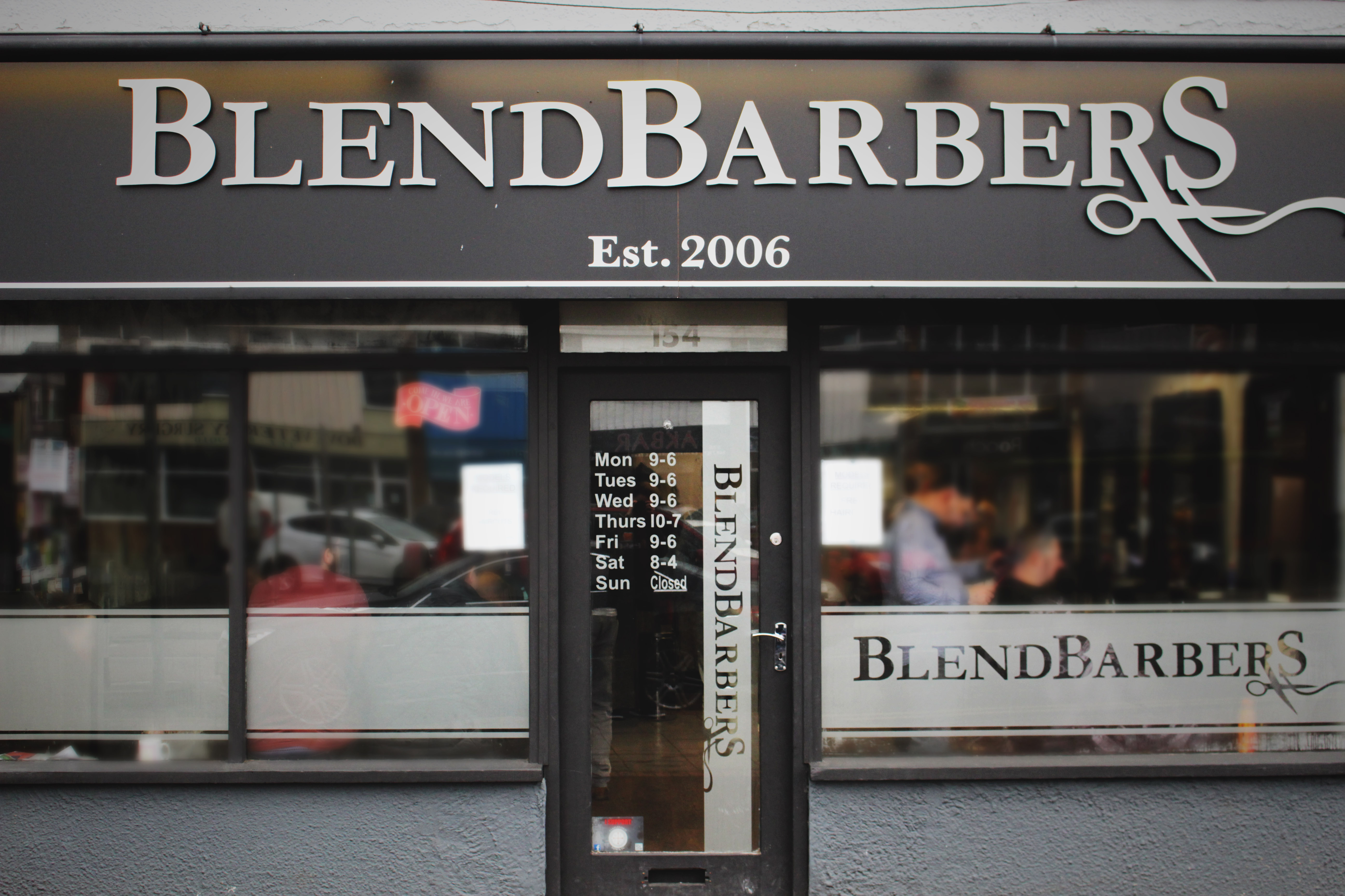 Shop front for blend barbers with opening hours